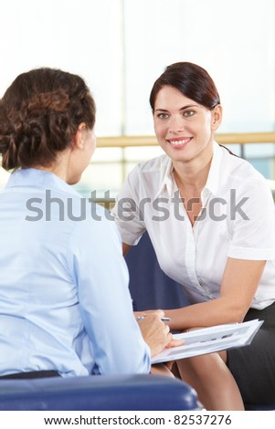 Portrait of confident businesswomen consulting in office