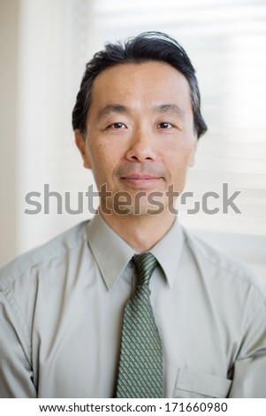 Portrait of confident cancer specialist smiling in hospital - stock photo