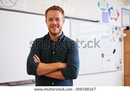 Portrait of confident Caucasian male teacher in classroom