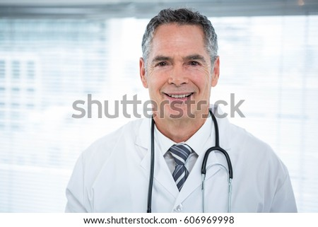 Portrait of confident doctor smiling