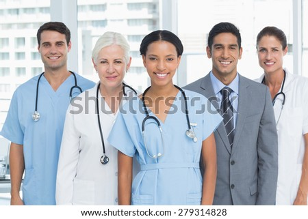 Portrait of confident doctors standing in medical office - stock photo