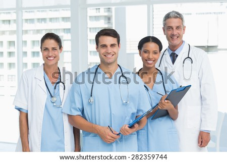 Portrait of confident doctors with arms crossed standing in medical office