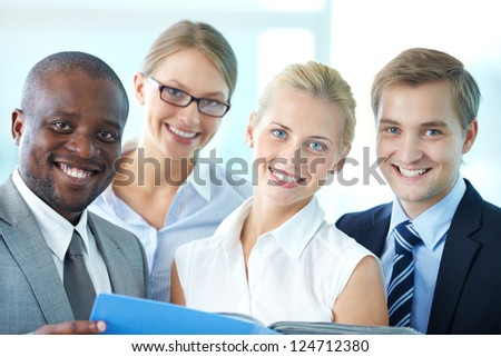 Portrait of confident employees looking at camera with smiles - stock photo