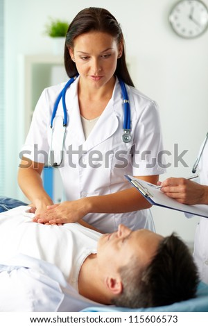 Portrait of confident female doctors during medical treatment of patient in hospital