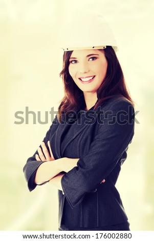 Portrait of confident female worker in white helmet  - stock photo