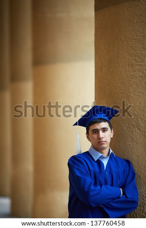 Portrait of confident graduation student looking at camera - stock photo