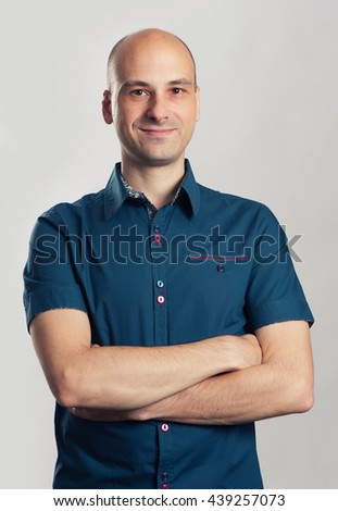 portrait of confident handsome bald man smiling