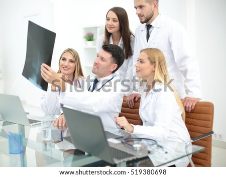 Portrait of confident happy group of doctors working at the medi