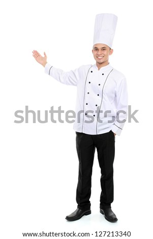 Portrait of confident male chef smiling presenting blank space for your text - stock photo
