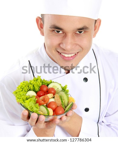 Portrait of confident male chef with healthy food - stock photo