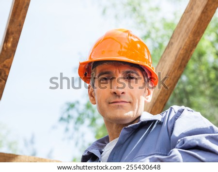 Portrait of confident male construction worker at site - stock photo