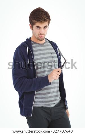 Portrait of confident man holding straight edge razor against white background - stock photo