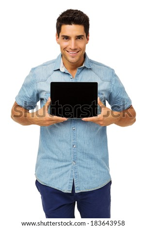 Portrait of confident man showing digital tablet isolated over white background. Vertical shot. - stock photo