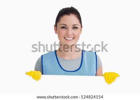 Portrait of confident mature mechanic with wrench standing over white background - stock photo