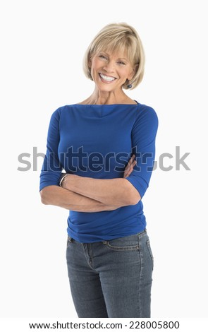 Portrait of confident mature woman standing arms crossed over white background - stock photo