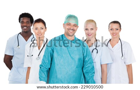 Portrait of confident medical team standing against white background