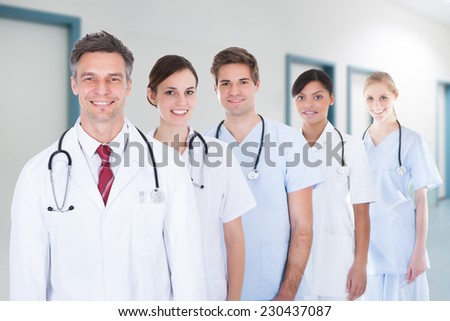 Portrait of confident medical team standing in row at hospital