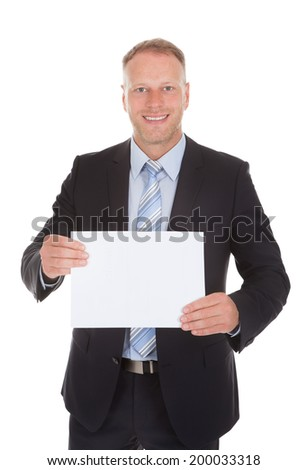 Portrait of confident mid adult businessman holding wooden plank over white background - stock photo