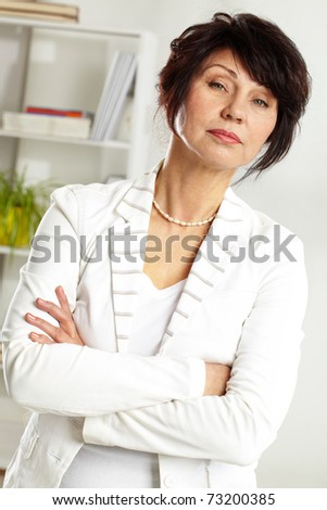 Portrait of confident middle-aged female looking at camera
