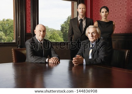 Portrait of confident multiethnic business team in conference room - stock photo
