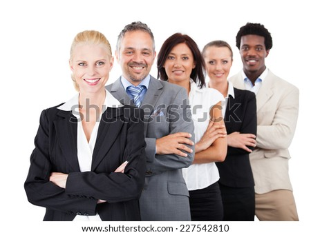 Portrait of confident multiethnic businesspeople standing arms crossed over white background - stock photo