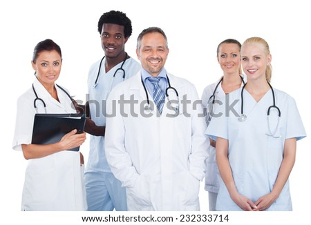 Portrait of confident multiethnic medical team standing over white background - stock photo