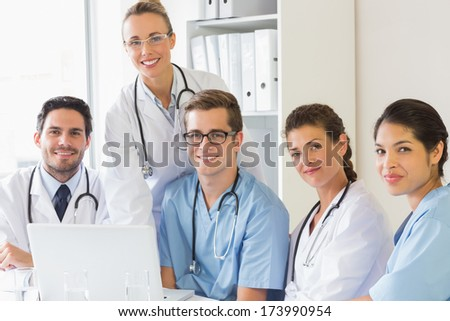 Portrait of confident nurses and doctors in hospital - stock photo