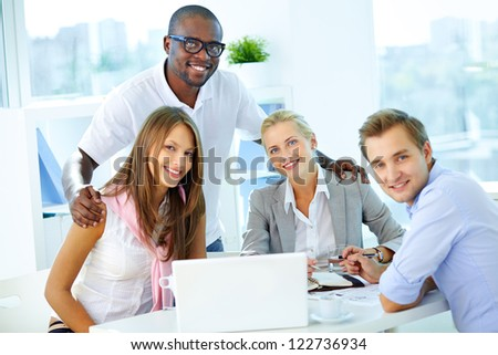 Portrait of confident partners looking at camera at workplace - stock photo