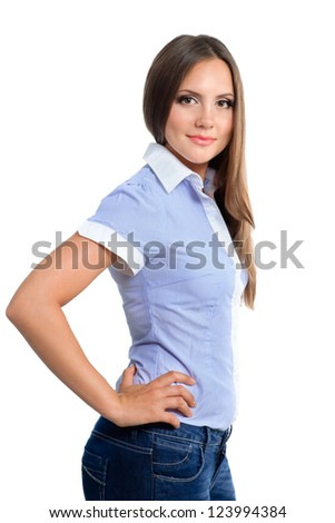 portrait of confident pretty girl wearing blue shirt while standing over white background - stock photo