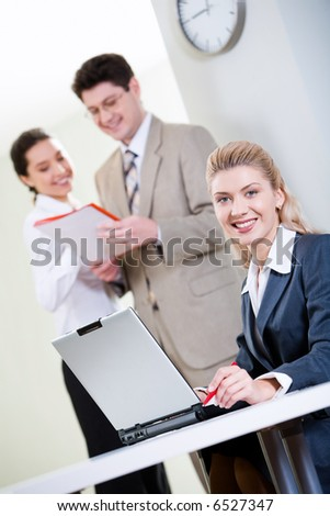 Portrait of confident receptionist in a working environment