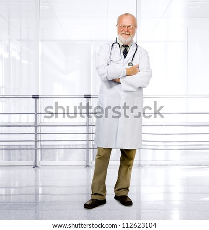 Portrait of confident senior medical doctor on clinic background - stock photo