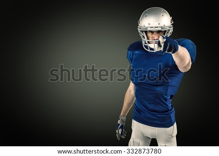 Portrait of confident sports player pointing against green background with vignette