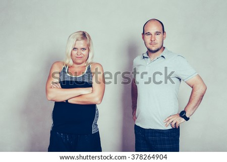 Portrait of confident sporty corpulent couple. - stock photo