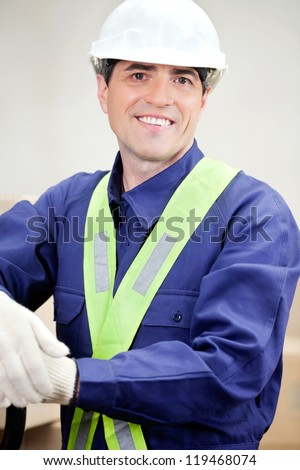 Portrait of confident warehouse worker at workplace - stock photo