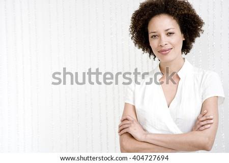 Portrait of confident woman in a white wraparound top - stock photo