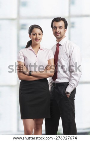 Portrait of confident young business colleagues in office - stock photo