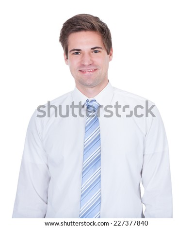 Portrait of confident young businessman smiling against white background