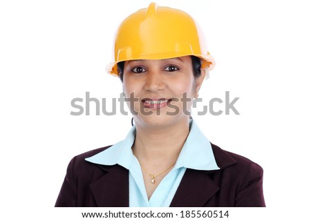 Portrait of confident young female architect against white background
