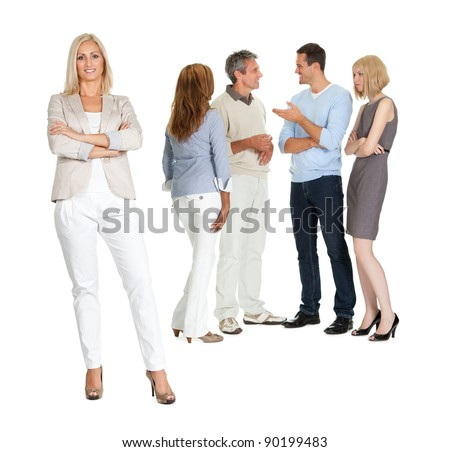 Portrait of confident young lady with group of people talking in background