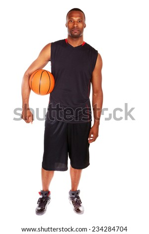 Portrait of confident young male athlete with basketball standing over white background - stock photo