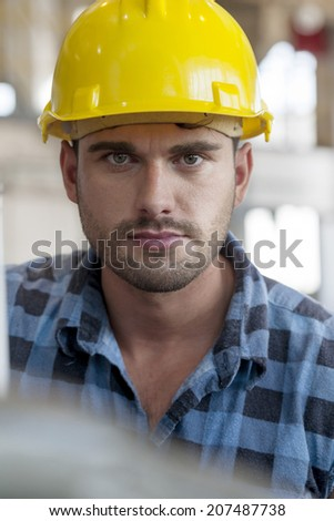 Portrait of confident young male worker in industry - stock photo