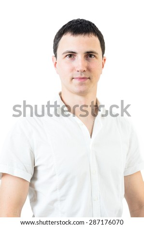 Portrait of confident young man sitting in office. White background