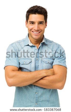Portrait of confident young man standing arms crossed against white background. Vertical shot. - stock photo