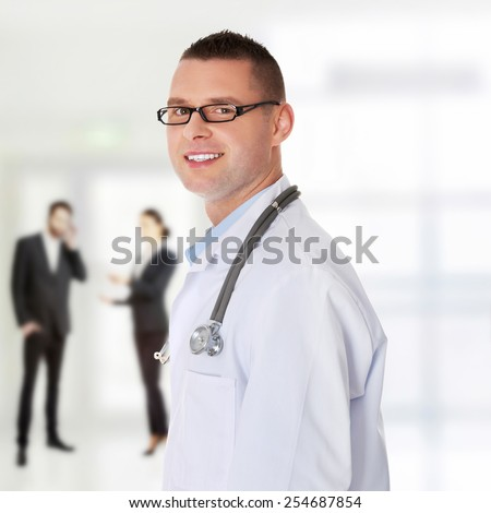 Portrait of confident young medical doctor - stock photo