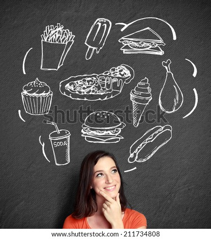 portrait of confuse young woman looking up thinking what to eat. fast food concept - stock photo