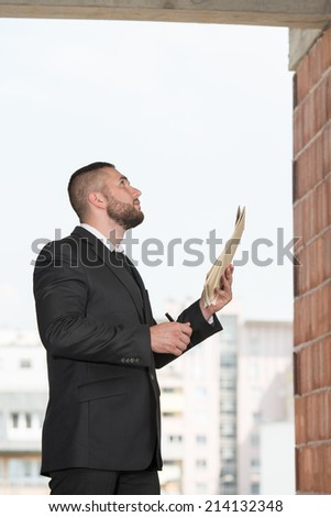 Portrait Of Construction Master With Blueprint In Hands