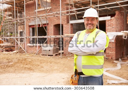 Portrait Of Construction Worker On Building Site - stock photo