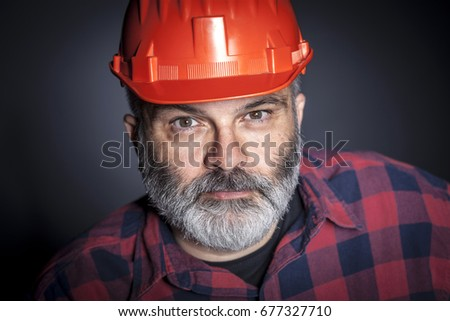 portrait of constructor with beard studio shot