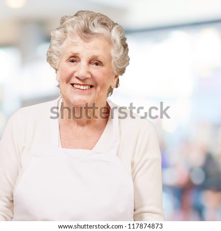 portrait of cook senior woman against a abstract background