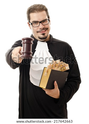 Portrait of corrupt judge with the law book and the money for a bribe isolated on white